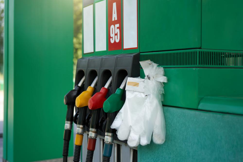 Disposable gloves hanging at a fuel station to protect against COVID-19